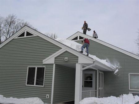 Men Shoveling On Roof