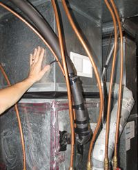 Hand on furnace plenum